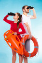 Lifeguards on duty looking through binoculars Royalty Free Stock Photo