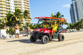 Lifeguards leave the beach huts miami usa july return at pm on july in miami usa patrol became existing in since that time ocean Stock Images