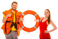 Lifeguards in life vest with ring buoy. Success. Royalty Free Stock Photo