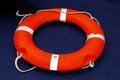 Lifering florescent orange lifebuoy life ring Stock Photography