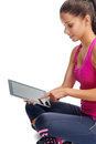 Lifestyle gym app healthy girl searches for new fitness apps on her computer tablet Stock Image