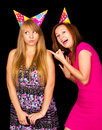 Lifestyle i age of two young friend girls making crazy funny faces wearing bright hipster clothes Stock Photography