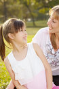 Lifestyle mum with daughter in funny pastime at the park outdoor Stock Photos