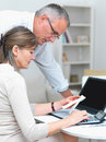 Lifestyle - Old couple doing their accounting Stock Photography