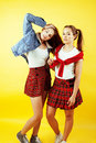 Lifestyle people concept: two pretty stylish modern hipster teen girl having fun together, happy smiling making selfie Royalty Free Stock Photo
