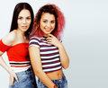 Lifestyle people concept: two pretty stylish modern hipster teen girls having fun together, diverse nation mixed races