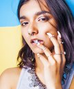 Lifestyle people concept. young pretty smiling indian girl with Royalty Free Stock Photo