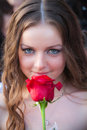 Lifestyle portrait of young woman with red rose Royalty Free Stock Image