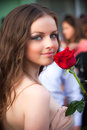 Lifestyle portrait of young woman with red rose Stock Images
