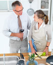 Lifestyles -  loving older couple in kitchen Stock Image