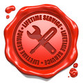 Lifetime service stamp on red wax seal slogan with icon of crossed screwdriver and wrench white business concept Royalty Free Stock Photography