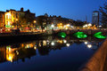 Liffey river in dublin at dusk lights ireland Stock Photos