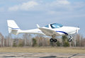 A light aircraft above runway modern lightweight plane is landing or taking off on the aerodrome Stock Images