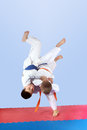 On a light background athletes is doing judo throws Stock Image