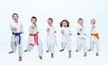 On a light background six karateka beating punch arm Royalty Free Stock Photo