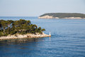 Light beacon on point of land a a the coast croatia Royalty Free Stock Photo