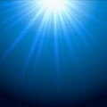 Light beams sparkling blue background