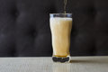 Light beer pouring in glass Royalty Free Stock Photo