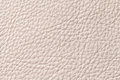Light beige beige leather texture background with pattern, closeup.