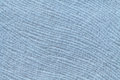 Light blue background from soft textile material. Fabric with natural texture. Royalty Free Stock Photo