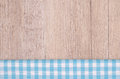 Light blue checkered cloth on wood as background Royalty Free Stock Photos