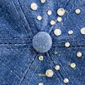 Light blue denim with blue and silver rhinestones background closeup Royalty Free Stock Images