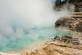 Light blue pool of Excelsior geyser with steam rising from hot spring in Midway basin Royalty Free Stock Photo