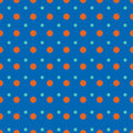 Light blue and red dots on blue background pattern Stock Photos