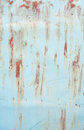 Light blue wall with rusty stains
