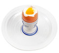 Light boiled egg in egg cup on white plate Royalty Free Stock Photo