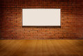 Light box or white board on brick grunge wall and wood floor in room Royalty Free Stock Photo