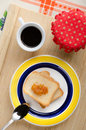 Light breakfast bread rusks with apricot jam and a cup of coffee Stock Photo