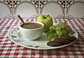 Light breakfast coffee mokka apple white grapes cookie with cereals and dark chocolate Royalty Free Stock Photography