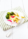 Light breakfast with fried cutted egg black coffee and vegetabl fresh vegetables on white wooden background Stock Images