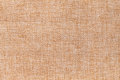 Light brown background of dense woven bagging fabric, closeup. Structure of the textile macro. Royalty Free Stock Photo