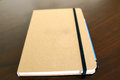 light brown notepad book and pencil Royalty Free Stock Photo