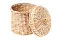 Light brown wicker basket with open lid isolated on white background Royalty Free Stock Images