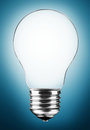 Light bulb on blue background Stock Photos