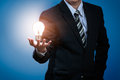 Light bulb in businessman s hand Royalty Free Stock Photos