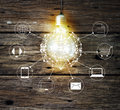 Light bulb circle global and icon customer network connection on wooden background omni channel or multi channel Royalty Free Stock Photo