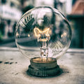 Light bulb close up with street view reflection tokyo and blurry background Stock Photos