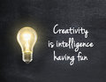 Light bulb with creativity quote Royalty Free Stock Photo