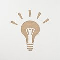 Light bulb cut out on a corrugated cardboard Stock Photo