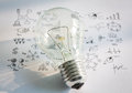 Light bulb with drawing graph and chart Royalty Free Stock Images