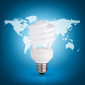 Light bulb energy saver on blue background world map Stock Images