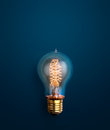 light bulb glowing on blue background creative ideas background Royalty Free Stock Photo