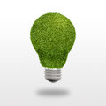 Light bulb with grass instead of glass on a white background Royalty Free Stock Photo