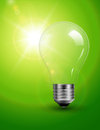 Light bulb on green Stock Photo
