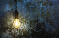 Light bulb on grunge wall Royalty Free Stock Photo