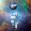 Light bulb hand earth and Stock Images